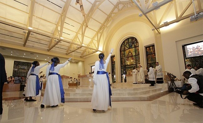 Haitian dancers sway to a gentle beat at the beginning of the Mass to dedicate Notre Dame d'Haiti's new church.