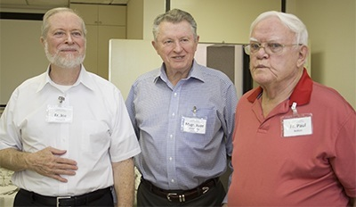 Posing for a photo, from left: Father Joseph Fishwick, retired, Msgr. Jude O'Doherty, luncheon host and Epiphany pastor, and Father Paul Bolton, retired.