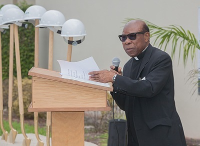 St. Henry pastor, Father Francis Akwue addresses crowd at groundbreaking
