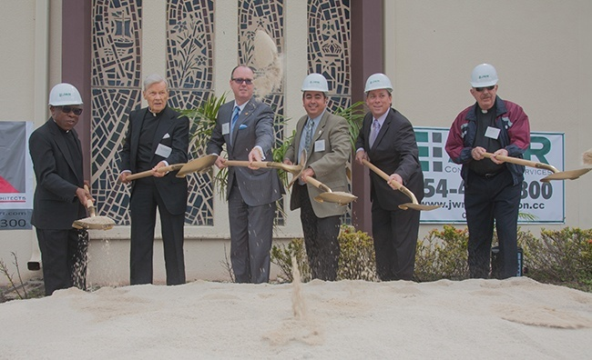 Breaking ground for the addition, from left: St. Henry's pastor, Father Francis Akwue; pastor emeritus, Msgr. James Reynolds; Pompano Beach Mayor Lamar Fisher; David Prada, senior director of Building and Construction for the archdiocese; Brian Herbert, of Gallo Herbert Architects; and Msgr. John Glorie, a retired archdiocesan priest.