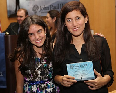 """Lilimar Hernandez, left, principal actress in the film """"Pedro Pan,"""" poses with its writer and director, Andrea Puente, who won the Reel Rose Award for Best Short Screenplay."""