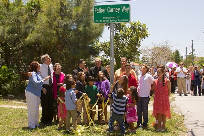 On April 27, the City of Miami Springs designated a street in honor of longtime Blessed Trinity pastor Father Joseph Carney. Over 100 parishioners and city council members attended the the event, along with Father Carney's brother, Tim, who traveled with his wife from Cleveland, Ohio.