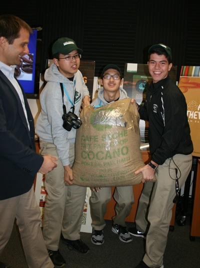 McCarthy students carry a ready for market 100-pound bag of Café Cocano.