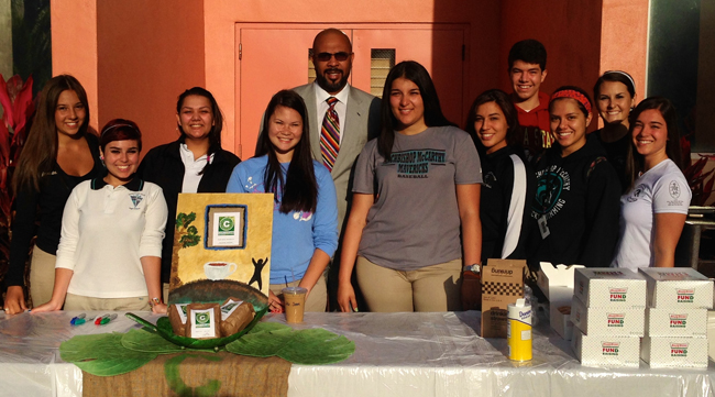 McCarthy's social entrepreneurship students with Principal Richard Jean at the school's iced Caf� Cocano sale.