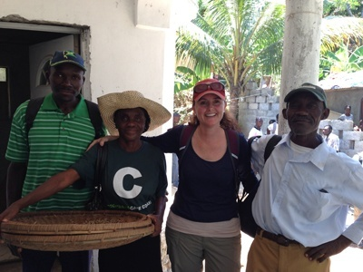 Archbishop McCarthy social entrepreneurship teacher Kim Zocco poses with members of the Caf� Cocano cooperative in Port de Paix, Haiti.