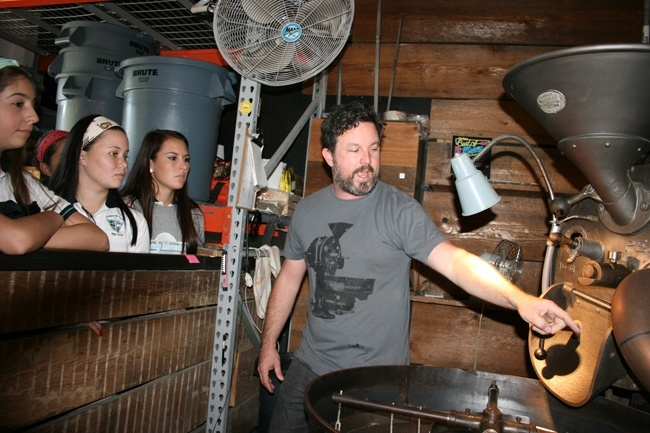 Joel Pollock of Panther Coffee shows Archbishop McCarthy students how the Caf� Cocano coffee they brought in is roasted.