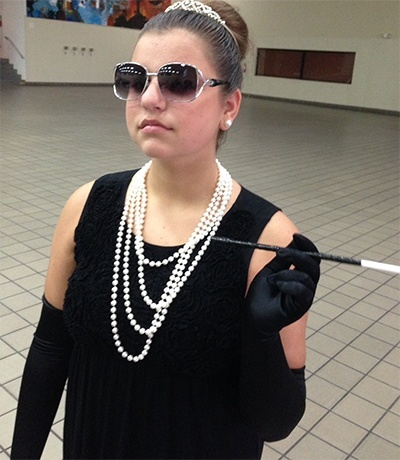 Our Lady of the Lakes student Elizabeth Maisello dresses up as Audrey Hepburn for Celebrity Day at Msgr. Edward Pace High School's annual drama camp.