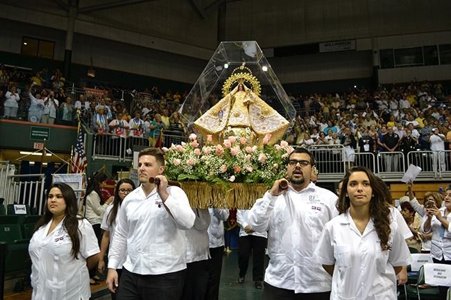Members of Encuentros Juveniles, a group for youths and young adults, carry the image of Our Lady of Charity, patroness of Cuba, through the BankUnited Center in Coral Gables during the annual celebration of her feast day Sept. 8.