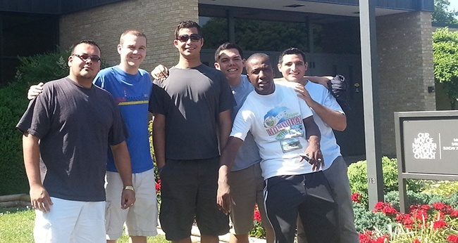 Miami seminarians at Our Lady of Nazareth Church in Roanoke, Va., where they picked up donated items to take and distribute at numerous migrant worker camps throughout the summer. From left: Miami seminarians Andres Pareja, Enzo Rosario, Nick Toledo, Remy Jeudy and Juan Suarez pose with Richmond seminarian Kyle O'Connor (second from left).