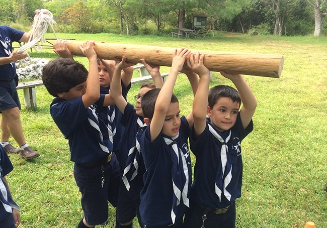 Otters participate in a game involving strength and teamwork during a May campout at Bill Sadowski Park in Palmetto Bay.