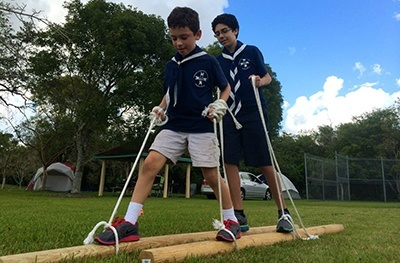 Timber Wolves Andres Jimenez and Jake Sivilla participate in a game requiring coordination and cooperation during a campout at Camp Owaissa Bauer in February 2014.
